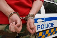 Handcuffed man. Man handcuffed in police car Stock Images