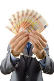 Handcuffed man with  banknotes Royalty Free Stock Image
