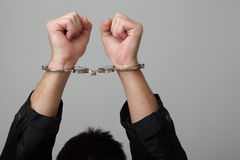 Handcuffed man. Stock Photos