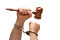 Handcuffed Man Holding Wooden Gavel on White Royalty Free Stock Image