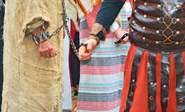 Handcuffed  prisoner. Roman soldier and handcuffed  prisoner Stock Photography