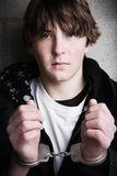 Handcuffed teen portrait. Close up stock photo
