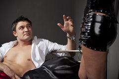 Handcuffed to the bed. Man handcuffed to the bed during sexual games stock images