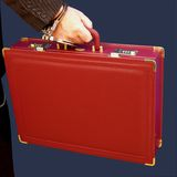 Handcuffed to a briefcase. Someone handcuffed to a briefcase for security Royalty Free Stock Image