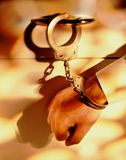 Handcuffed to Desk. Business person handcuffed to desk Stock Images
