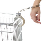 Handcuffed woman hand  pinned to shop cart Stock Photography