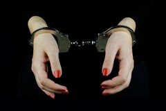 Handcuffed woman hands Royalty Free Stock Photos