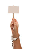 Handcuffed Woman Holding Blank White Sign Isolated Stock Photography
