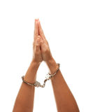 Handcuffed Woman Raising Hands in Air on White. Handcuffed Woman Desperately Raising Hands in Air Isolated on a White Background Royalty Free Stock Photos