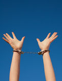 Handcuffed woman's hands Stock Images