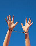 Handcuffed woman's hands Stock Photos