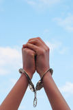 Handcuffed woman's hands Royalty Free Stock Photo