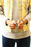 Handcuffed Young Suspect. Handcuffed young crime suspect being taken away to police custody Stock Photos