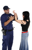 Handcuffing a ciminal Royalty Free Stock Photos