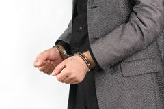Handcuffs. Hand of a young man in handcuffs Stock Photography