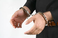 Handcuffs. Hand of a young man in handcuffs Stock Images