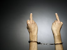 Handcuffs. A man hands  with handcuffs isolated on black background Stock Images