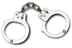 Handcuffs. Metal handcuffs on white with clipping path