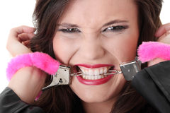 Handcuffs. Woman with pink handcuffs trying to get free Stock Photos