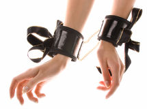 Handcuffs. Leather handcuffs with golden chains on isolated background Royalty Free Stock Photography