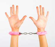 Handcuffs. Pink handcuffs, with fur Stock Image