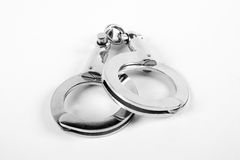 Handcuffs. A pair of handcuffs and then on a white background Stock Photo