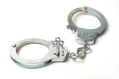 Handcuffs against white background Stock Photo