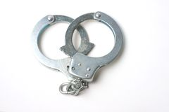 Handcuffs against white background Stock Photos