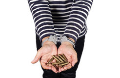 Handcuffs and ammunition.Concept of criminal acts. Stock Photography