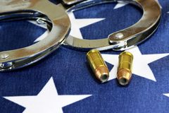 Handcuffs and ammunition on United States Flag Royalty Free Stock Image