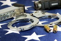 Handcuffs and ammunition on United States Flag Stock Photo
