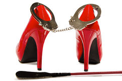 Handcuffs And High Heels Royalty Free Stock Image