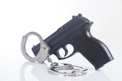 Handcuffs And Police Gun Royalty Free Stock Photos