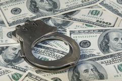 Handcuffs ands cash Stock Photography