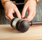 Handcuffs. The arrest of the offender in the courtroom Stock Images