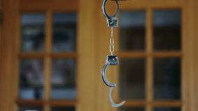 Handcuffs for arrested criminals, suspended in motion. Handcuffs for arrested criminals, suspended in motion stock video footage