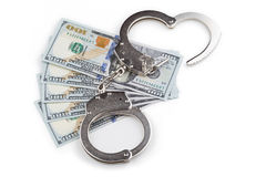 Handcuffs on the background of banknotes Stock Photography