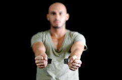 Handcuffs on bald young man, isolated on black Royalty Free Stock Image
