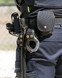 Handcuffs and baton dutch police officer Stock Image