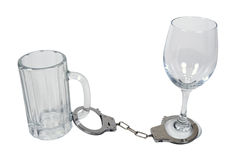 Handcuffs on Beer Mug and Wine Glass Royalty Free Stock Photos