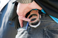 Handcuffs on belt Royalty Free Stock Photo