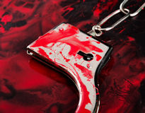 Handcuffs in blood Stock Photography
