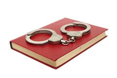 Handcuffs and book Stock Image
