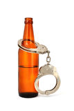 Handcuffs and bottle Royalty Free Stock Photography