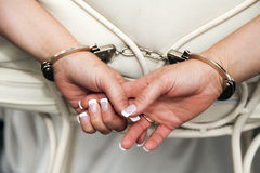 Handcuffs bride Stock Photo