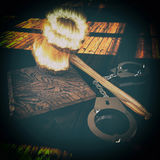 Handcuffs and burning gavel 3d illustration Royalty Free Stock Images