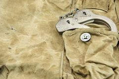 Handcuffs in The Camouflage Army Pants Pocket or Haversack. Or Bag or Fabric. Backgrond  and Texture Royalty Free Stock Image