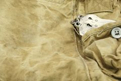 Handcuffs in The Camouflage Army Pants Pocket or Haversack. Or Bag or Fabric. Backgrond  and Texture Royalty Free Stock Photography