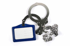 Handcuffs with chain and name tag Royalty Free Stock Photos
