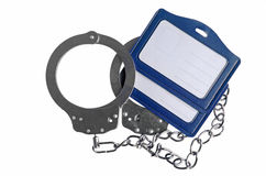 Handcuffs with chain and name tag Royalty Free Stock Photo
